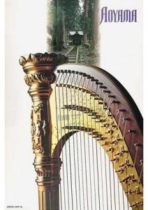 青山ハープのブランドイメージポスター。ハープの柱頭のゴールドの彫刻部分と背景に永平寺の緑の大木との合成イメージ。