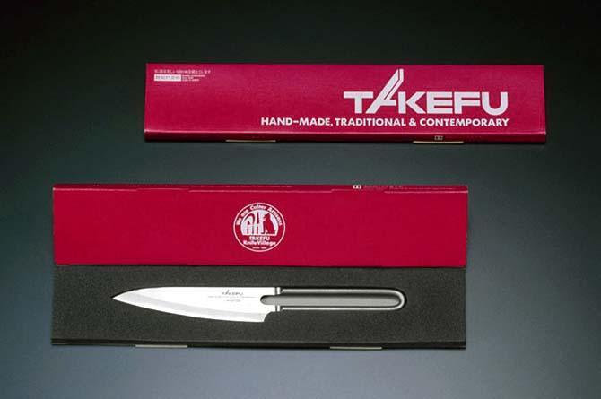 TAKEFU クレウス12P(ペティナイフ)のパッケージ.緩衝剤をナイフの形にくり抜き、そこにナイフをはめ込んだものを紙ケースでくるんだパッケージ。開いて展示したときと閉じた場合の二つの写真。